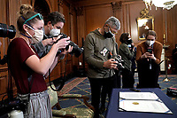 Photographers make pictures of H.R. 24, an article of impeachment against President Donald Trump, is seen prior to an engrossment ceremony on Wednesday, January 13, 2021 at the U.S. Capitol.<br /> Credit: Greg Nash / Pool via CNP /MediaPunch