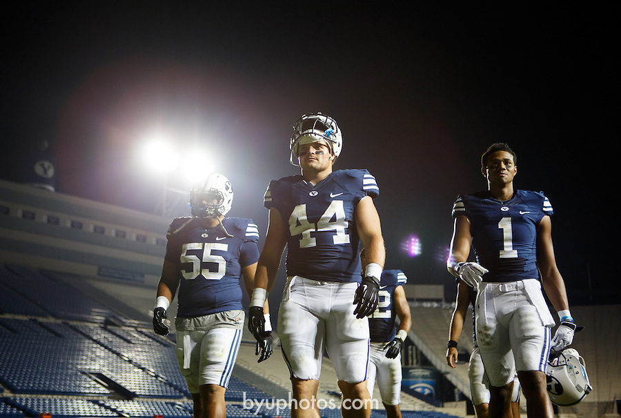 1208-48 756<br /> <br /> 1208-48 BYUtv FTB Ad, Players walking off field, Football, LVES Lavell Edwards Stadium.<br /> <br /> August 17, 2012<br /> <br /> Photo by Jaren Wilkey/BYU<br /> <br /> © BYU PHOTO 2012<br /> All Rights Reserved<br /> photo@byu.edu  (801)422-7322