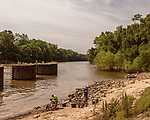 May 5, 2018. Fayetteville, North Carolina.<br /> <br /> People fish at the William O Huske Dam on the Cape Fear River. This is the dam closest to the Chemours plant.<br /> <br /> The Chemours Company, a spin off from DuPont, manufactures many chemicals at its plant in Fayetteville, NC. One of these, commonly referred to as GenX, is part of the process of teflon manufacturing. Chemours has been accused of dumping large quantities of GenX into the Cape Fear River and polluting the water supply of city's down river and allowing GenX to leak into local aquifers.