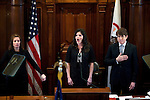 A week after the Illinois House voted to impeach him, Gov. Rod Blagojevich led the senate inauguration ceremony at the Illinois State Capitol in Springfield, Ill. Molly Durand, center, sings the national anthem at the session's opening..Kristen Schmid Schurter