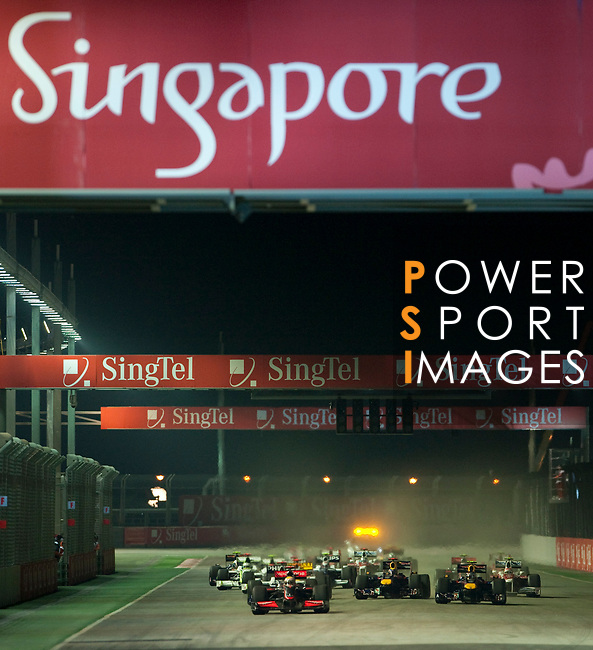 27 Sept 2009, Singapore --- Vodafone McLaren Mercedes F1 Team driver Lewis Hamilton of Great Britain leads the pack at the start of the Fia Formula One 2009 Singtel Singapore Grand Prix, the world's only street night race, at the Marina Bay street circuit. Photo by Victor Fraile --- Image by © Victor Fraile/Corbis