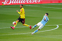 Phil Foden of Man City (right) shoots under pressure from Roberto Pereyra of Watford during the Premier League match between Watford and Manchester City at Vicarage Road, Watford, England on 21 July 2020. Football Stadiums around remain empty due to the Covid-19 Pandemic as Government social distancing laws prohibit supporters inside venues resulting in all fixtures being played behind closed doors until further notice.<br /> Photo by Andy Rowland.