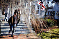 Joined by local politicians, Republican presidential candidate Mitt Romney, former governor of Massachusetts, walks through a neighborhood and knocks on the doors of likely primary voters in Manchester, New Hampshire, on Sat. Dec. 3, 2011. The neighborhood traditionally votes Republican.