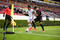 , MEXICO - : Sebastian Saucedo #10 of the United States battles with Manuel Mayorga #3 of Mexico during a game between  and undefined at  on ,  in , Mexico.