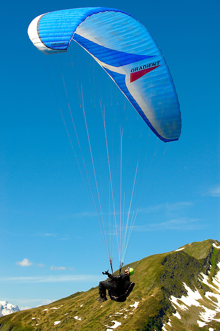 Paragliders in the Swiss Alps above the Grindelwald valley - Swiss Alps - Switzerland