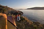 Sea kayak camping, Strawberry Island, San Juan Islands, Puget Sound, Salish Sea, Washington State, U.S.A., Washington State Department of Natural Resources, Cypress Island Natural Resources Conservation Area, model released,