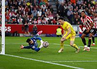 25th September 2021; Brentford Community Stadium, London, England; Premier League Football Brentford versus Liverpool; Goalkeeper David Raya of Brentford saves the ball from Diogo Jota of Liverpool