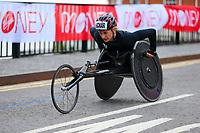 3rd October 2021; London, England: The Virgin Money 2021 London Marathon: Manuela Schär of Switzerland in the lead of the women's wheelchair race crossing Narrow Street Swing Bridge, Limehouse Basin between mile 14 and 15.