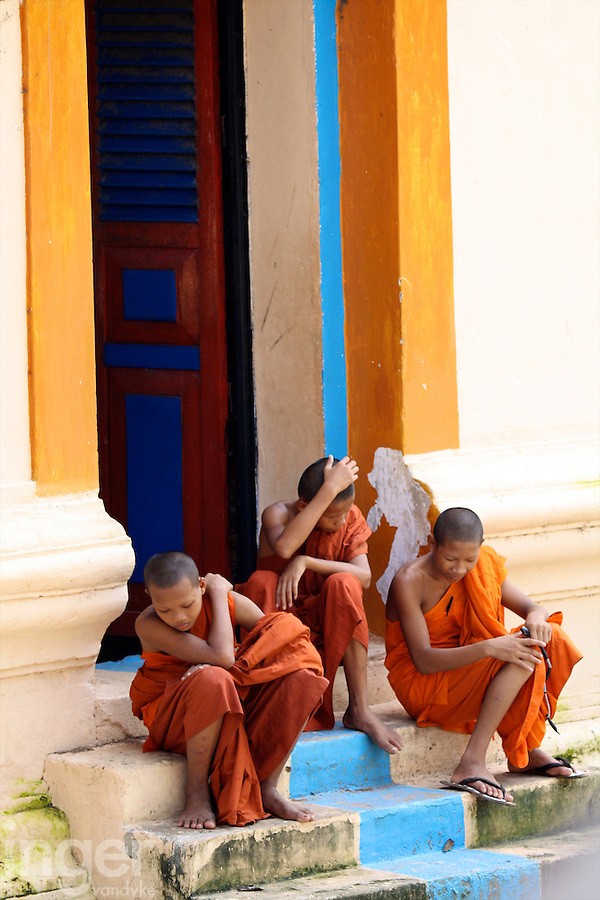 Seated monks at the Rolluas temple complex of Angkor, Cambodia