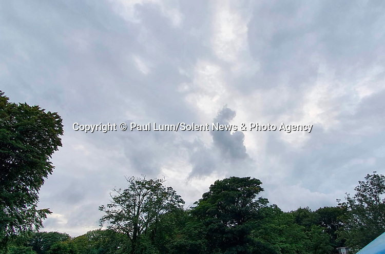 """An image of a woman with her baby is formed in clouds in the sky over Caernarfon, North Wales last night, Monday.<br /> <br /> Paul Lunn who snapped this photo of the clouds said, """"It looks like a mother holding her child""""<br /> <br /> Paul from Rochford, Essex was on holiday in Wales visiting family and was sat on a veranda along the river Seiont when he spotted the cloud formation.<br /> <br /> """"It was my first time having had proper contact with her (mum) since February as she has been shielding. It was a very poignant cloud for the moment""""<br /> <br /> Please byline: Paul Lunn/Solent News<br /> <br /> © Paul Lunn/Solent News & Photo Agency<br /> UK +44 (0) 2380 458800"""
