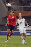 Lori Chalupny, Alex Scott. The USA defeated England, 3-0 during the quarterfinals of the FIFA Women's World Cup in Tianjin, China.  The USA defeated England, 3-0.