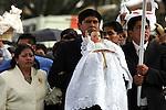 Mexico (02/02/2005): Baby Jesus known as the Ninopa is cradled by the Mayordomo as he is taken to his new home after an open mass in the Cathedral of Xochimilco, February 2, 2005. Tousands of people take their Baby Jesus to be blessed by priests. Mexico (02/02/2005) El Ninopa es cargado por el Mayordomo, camino a su nueva casa, al salir de una misa al aire libre en la Catedral de Xochimilco. Miles de vecinos llevan sus imagenes para ser bendecidas por los sacerdotes...© Heriberto Rodriguez..NO ARCHIVO-NO ARCHIVE-ARCHIVIERUNG VERBOTEN! ..