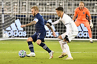 KANSAS CITY, KS - OCTOBER 24: Johnny Russell #7 of Sporting Kansas City watched by Cole Bassett #26 Colorado Rapids  during a game between  at Children's Mercy Park on October 24, 2020 in Kansas City, Kansas.
