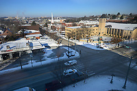 Traffic flows Friday, Feb. 19, 2021, along College Avenue past Dickson Street in Fayetteville. Roadways began to clear after days of plowing, sunshine and warmer temperatures on Friday. Visit nwaonline.com/210220Daily/ for today's photo gallery. <br /> (NWA Democrat-Gazette/Andy Shupe)