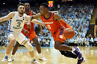 CHAPEL HILL, NC - JANUARY 11: Clyde Trapp #0 of Clemson University drives against Andrew Platek #3 of the University of North Carolina during a game between Clemson and North Carolina at Dean E. Smith Center on January 11, 2020 in Chapel Hill, North Carolina.