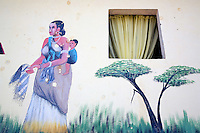 Djibouti. Djibouti province. Arta. Collectif des Jeunes d'Arta ( Collective of the Arta's young people). Mural painting. The drawing shows a mother carriying her child on her back and some trees.  © 2006 Didier Ruef