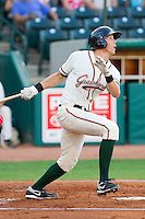 Kyle Skipworth #11 of the Greensboro Grasshoppers follows through on his swing against the Lakewood BlueClaws at NewBridge Bank Park July 6, 2010, in Greensboro, North Carolina.  Photo by Brian Westerholt / Four Seam Images
