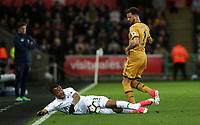 Jordan Ayew of Swansea City is challenged by Kyle Walker of Tottenham Hotspur during the Premier League match between Swansea City and Tottenham Hotspur at The Liberty Stadium, Swansea, Wales, UK. Wednesday 05 April 2017