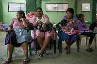 """A group of female indigenous and supporters of former Bolivian President Evo Morales, known as coca growers """"cocaleros"""", sit in the local coca market, in Entre Rios, Chapare province, Bolivia. November 27, 2019.<br /> Un groupe de femmes autochtones et partisanes de l'ancien président bolivien Evo Morales, connues sous le nom de """"cocaleros"""", cultivateurs de coca, est assis sur le marché local de la coca, à Entre Rios, province du Chapare, Bolivie. 27 novembre 2019."""