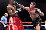 Oleg Maskaev and David Defiagbon (red) in the ring during their  10 rounds Heavyweight Fight at the Trump Taj Mahal Casino in Atlantic City, New Jersey on  07.23.04. Maskaev won by split decision.
