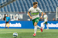 FOXBOROUGH, MA - AUGUST 26: Aaron Walker #8 of Greenville Triumph SC brings the ball forward during a game between Greenville Triumph SC and New England Revolution II at Gillette Stadium on August 26, 2020 in Foxborough, Massachusetts.