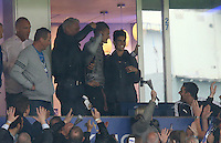 Jamie Vardy of Leicester City cups his hand to supporters chanting his name as he watches from the stands during the Barclays Premier League match between Leicester City and Swansea City played at The King Power Stadium, Leicester on 24th April 2016