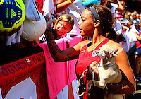 WASHINGTON D.C. - September 02, 2013:<br /> Sydney Leroux  signs autographs and balances her dog During a USA WNT open practice at RFK Stadium, in Washington D.C. the day before the USA v Mexico international friendly match.