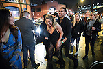 """© Joel Goodman - 07973 332324 . 17/12/2016 . Manchester , UK . A couple smile as they pass along Deansgate Locks . Revellers out in Manchester City Centre overnight during """" Mad Friday """" , named for being one of the busiest nights of the year for the emergency services in the UK . Photo credit : Joel Goodman"""