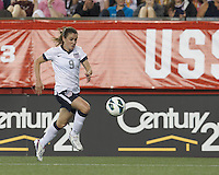 USWNT midfielder Heather O'Reilly (9) brings the ball forward. In an international friendly, the U.S. Women's National Team (USWNT) (white/blue) defeated Korea Republic (South Korea) (red/blue), 4-1, at Gillette Stadium on June 15, 2013.
