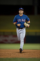 AZL Rangers center fielder Jose Cardona (11) jogs off the field between innings of an Arizona League game against the AZL Cubs 2 at Sloan Park on July 7, 2018 in Mesa, Arizona. AZL Rangers defeated AZL Cubs 2 11-2. (Zachary Lucy/Four Seam Images)