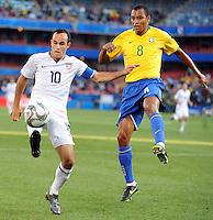 Landon Donovan (10) of USA and Gilberto Silva (8) of Brazil. Brazil defeated USA 3-0 during the FIFA Confederations Cup at Loftus Versfeld Stadium in Tshwane/Pretoria, South Africa on June 18, 2009.