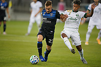 SAN JOSE, CA - SEPTEMBER 16: Tommy Thompson #22 of the San Jose Earthquakes is marked by Andy Polo #7 of the Portland Timbers during a game between Portland Timbers and San Jose Earthquakes at Earthquakes Stadium on September 16, 2020 in San Jose, California.