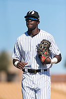 Glendale Desert Dogs left fielder Estevan Florial (13), of the New York Yankees organization, jogs off the field between innings of an Arizona Fall League game against the Mesa Solar Sox at Camelback Ranch on October 15, 2018 in Glendale, Arizona. Mesa defeated Glendale 8-0. (Zachary Lucy/Four Seam Images)