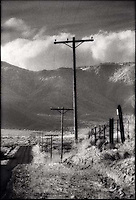 Telephone poles along desert road<br />