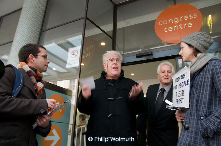Journalists and members of No Sweat argue with a Primark shareholder attending the company's AGM at the TUC's Congress House, London.