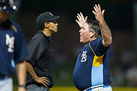 Myrtle Beach Pelicans manager Buddy Bailey (46) argues a call with first base umpire Ronnie Whiting during the game against the Winston-Salem Dash at BB&T Ballpark on May 11, 2017 in Winston-Salem, North Carolina.  The Pelicans defeated the Dash 9-7.  (Brian Westerholt/Four Seam Images)