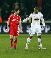 SWANSEA, WALES - MARCH 16: Joe Allen of Liverpool (L) shares a joke with former team mate Ashley Williams of Swansea after the Premier League match between Swansea City and Liverpool at the Liberty Stadium on March 16, 2015 in Swansea, Wales