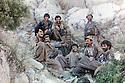 Irak 1989  .On june 25th, Mahmoud Sangawy, 2nd right, arriving from Iran, in Charbajer region with his peshmergas .Irak 1989 .Le 25 juin, entre Arbat et Barziaga, region de Charbajer, Mahmoud Sangawy , 2eme a droite, avec ses peshmergas vient d'arriver d'Iran