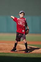 A young fan throws out a ceremonial first pitch prior to the game between the Hudson Valley Renegades and the Winston-Salem Dash at Truist Stadium on August 28, 2021 in Winston-Salem, North Carolina. (Brian Westerholt/Four Seam Images)