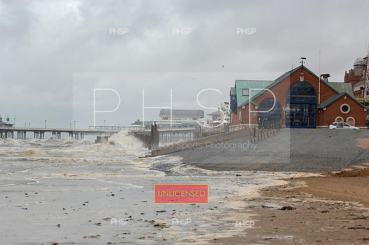 Blackpool 04.07.07.Incoming tide deposits debris on the beach