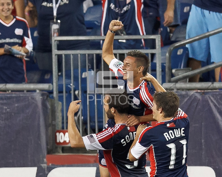 New England Revolution substitute forward Diego Fagundez (14) celebrates his 90+ minute tying goal with teammates. In a Major League Soccer (MLS) match, the New England Revolution tied the Seattle Sounders FC, 2-2, at Gillette Stadium on June 30, 2012.