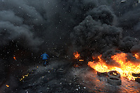 The battlefield is engulfed by the flames ignited by molotov cocktails used by the rioters during the   protest against new draconian law to ban the right to  protest across the country.  Kiev. Ukraine