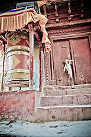 Large red Buddhist prayer wheel,  Naropa Royal Palace, Shey, Ladakh, India.