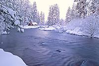 Metolius River in snow with cabin. Oregon