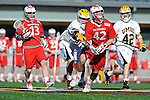 Baltimore, MD - March 3:  Midfielder Marshall Johnson #42 of the Fairfield Stags fights of UMBC defenders during the Fairfield v UMBC mens lacrosse game at UMBC Stadium on March 3, 2012 in Baltimore, MD.