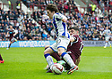 Hearts' Calum Paterson makes a challenge on Killie's Chris Johnston in the penalty area but Referee Calum Murray says he got the ball first.
