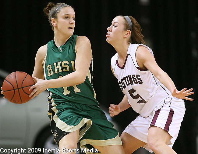 SIOUX CITY, IA - MARCH 14, 2009 --  Keely Krolikowski #11 of Black Hills State looks past Morningside defender Kayla Weerheim #5 of Morningside College during their 2009 NAIA DII Women's Basketball National Championship quarterfinal game Saturday at the Tyson Events Center in Sioux City. (Photo by Dick Carlson/Inertia)