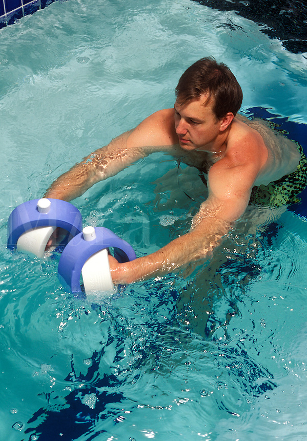 Patient engages in hydro therapy as part of his physical rehabilitation regimin.