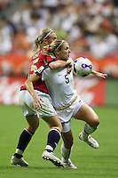 Norway midfielder (15) Madeleine Giske looks to slow USA defender (5) Lindsay Tarpley. The United States (USA) defeated Norway (NOR) 4-1 during the third place match of the Women's World Cup China 2007 at Shanghai Hongkou Football Stadium in Shanghai, China, on September 30, 2007.