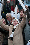 Swansea City Football fans celebrating during an open-top bus parade through the centre of Swansea after beating Bradford City 5-0 in Sunday's Capital One Cup final at Wembley to win the Capital Cup trophy.